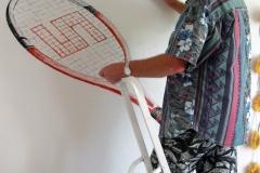 14- Tennisschläger mit Ball